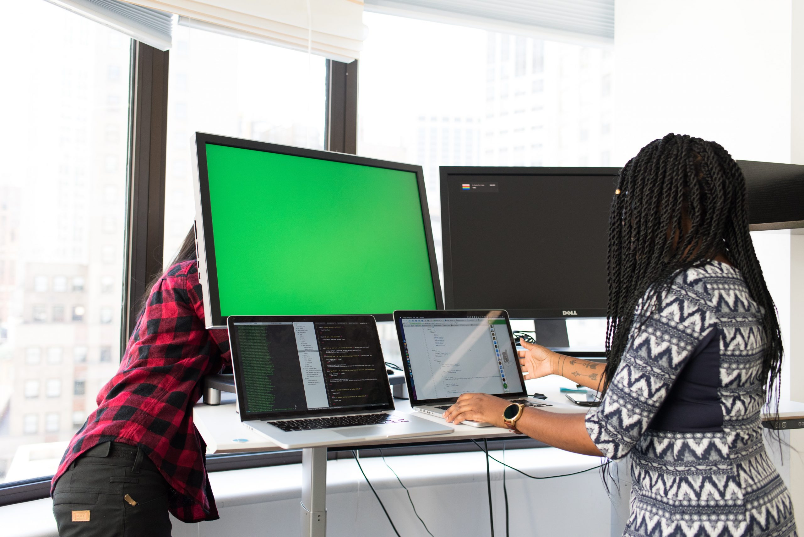 woman working on a computer in an office
